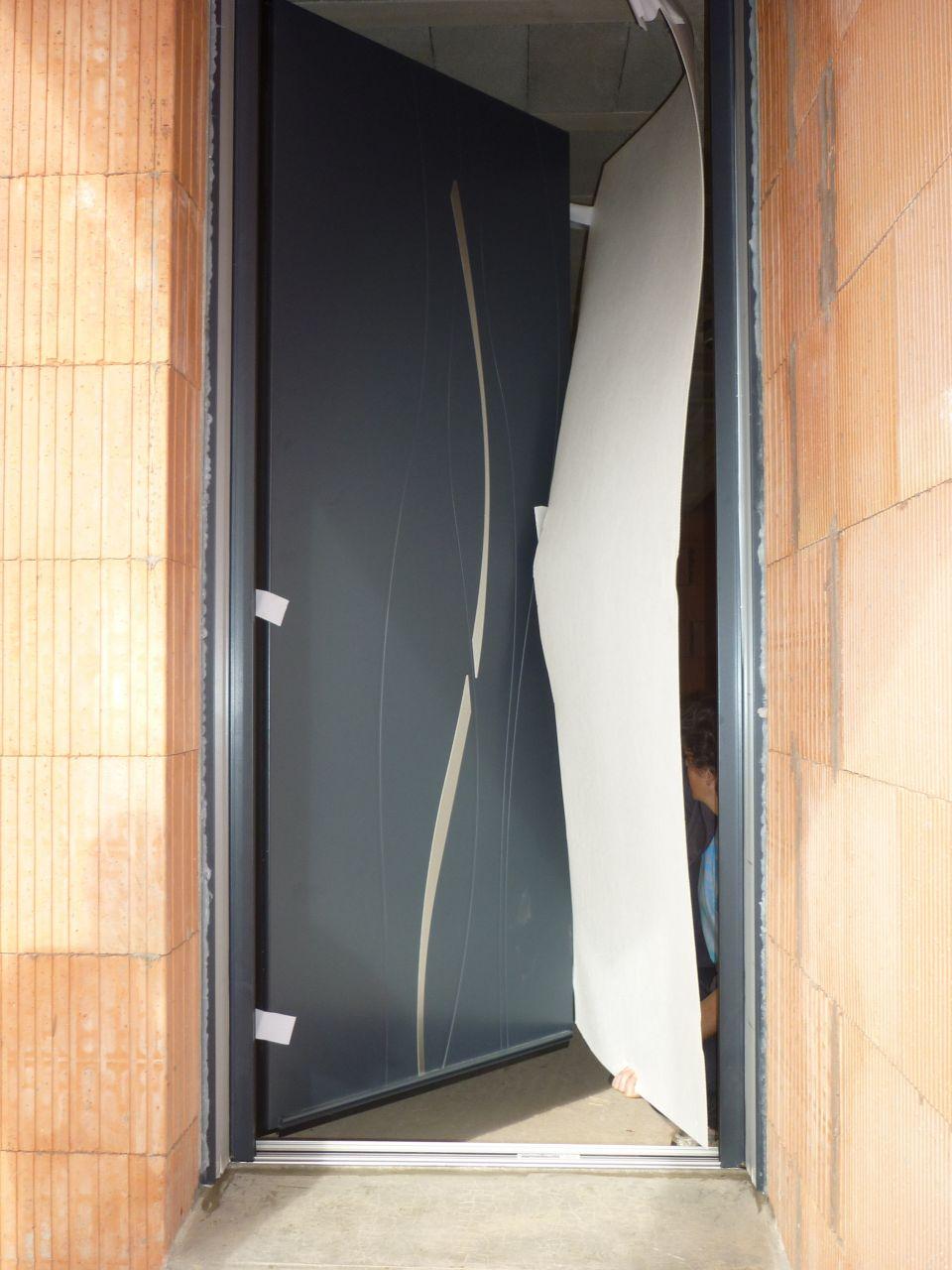Les menuiseries exterieur isolation finistere for Porte de garage eveno