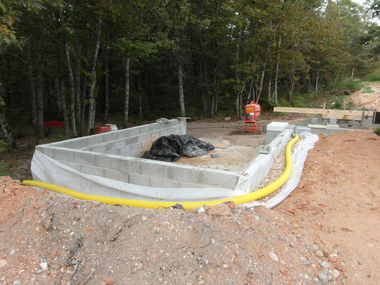 drain sur coulage beton autour du bac a sable