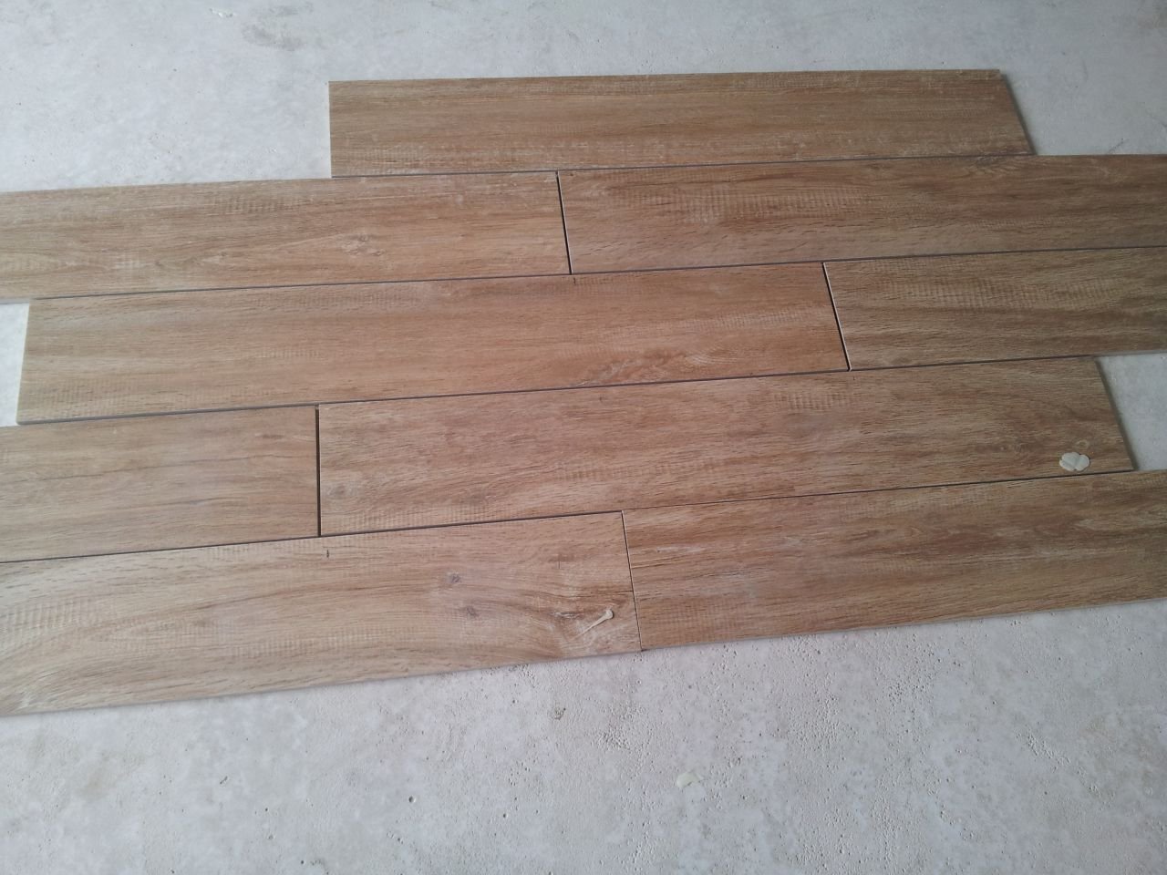 Sens et technique de pose pr carrelage imitation parquet for Pose en quinconce carrelage