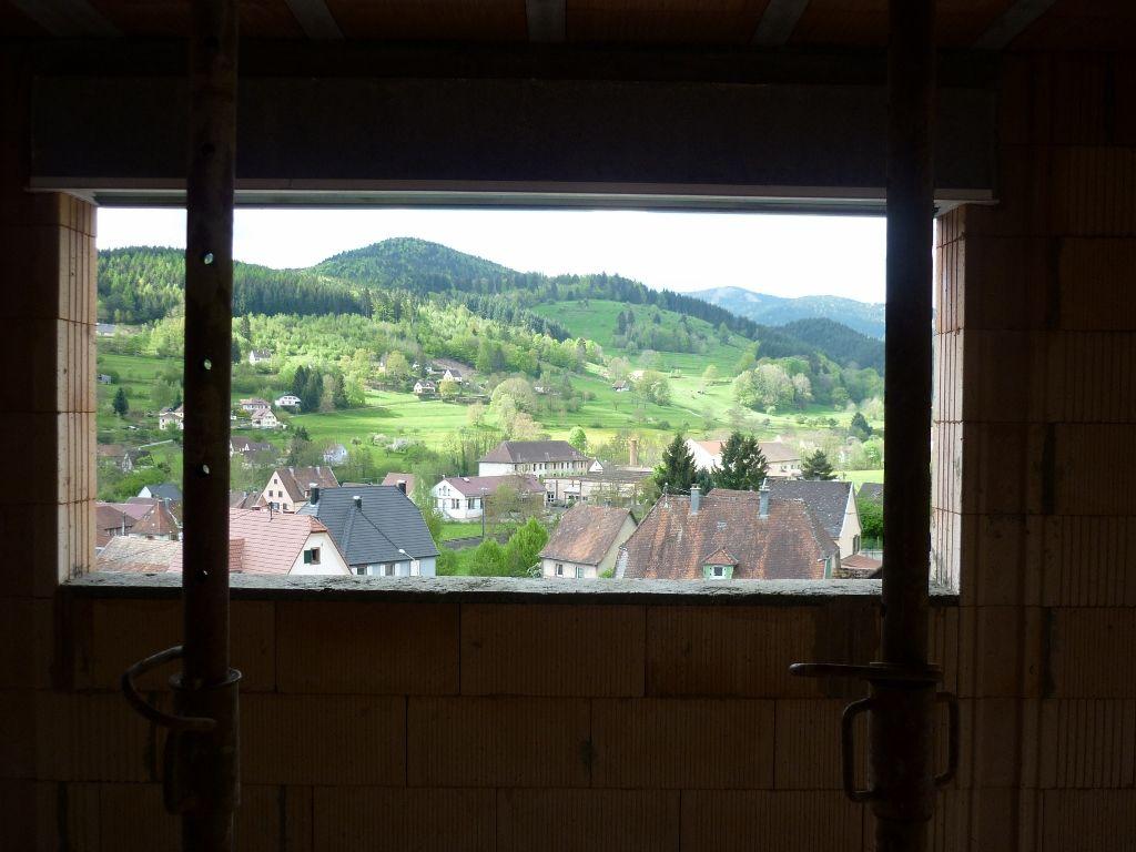 La vue par la fenêtre de la salle à manger (240X95)