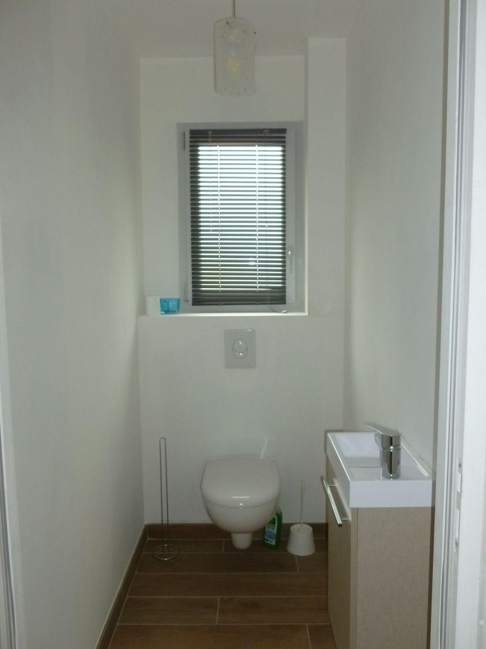 installation d'un store dans les WC