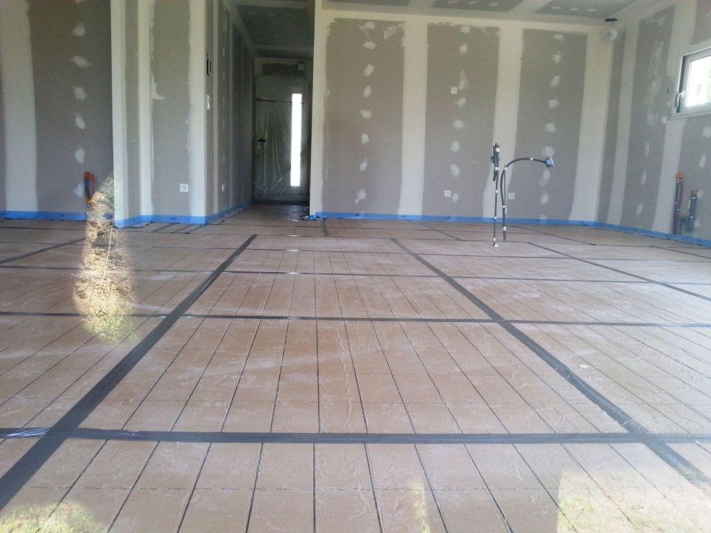 Pose de l'isolant du plancher chauffant