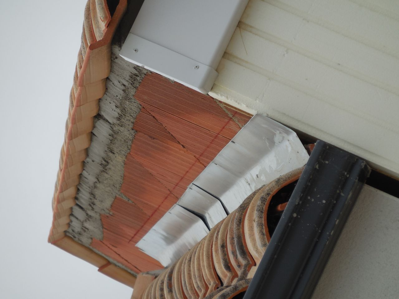 Jointure avec la toiture du voisin