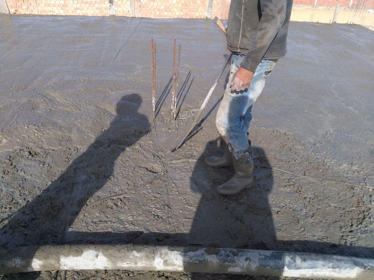Deuxième couche de béton en cours de coulage