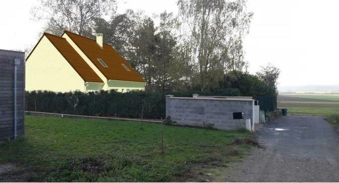 Photo du permis de construire, donnant un visuel informatique de la future maison ( il faut imaginer pour le coup une strcture bois à la place du garage) pas possible de faire mieux compte-tenu de la végétation en place sur le terrain.