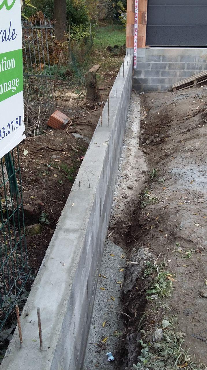 Fin du mur de soutènement en limite de propriété