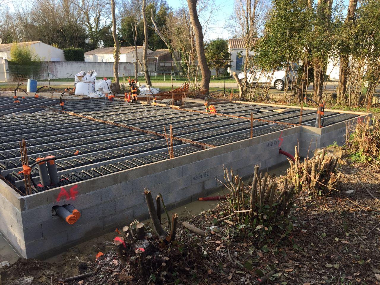 Incorporation plomberie et préparation plancher avant coulage