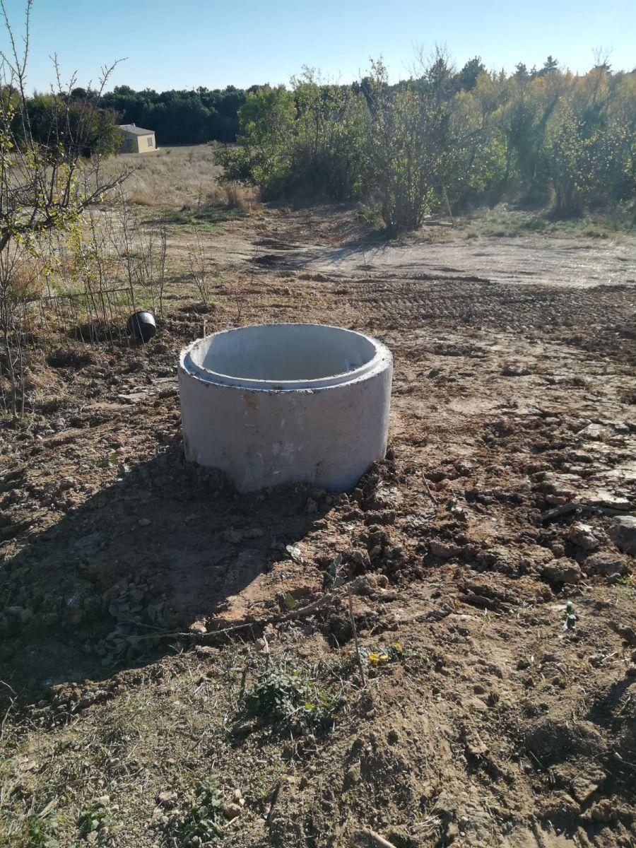 le puits est placé...