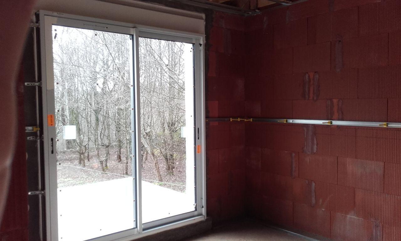 Baie vitrée de la chambre