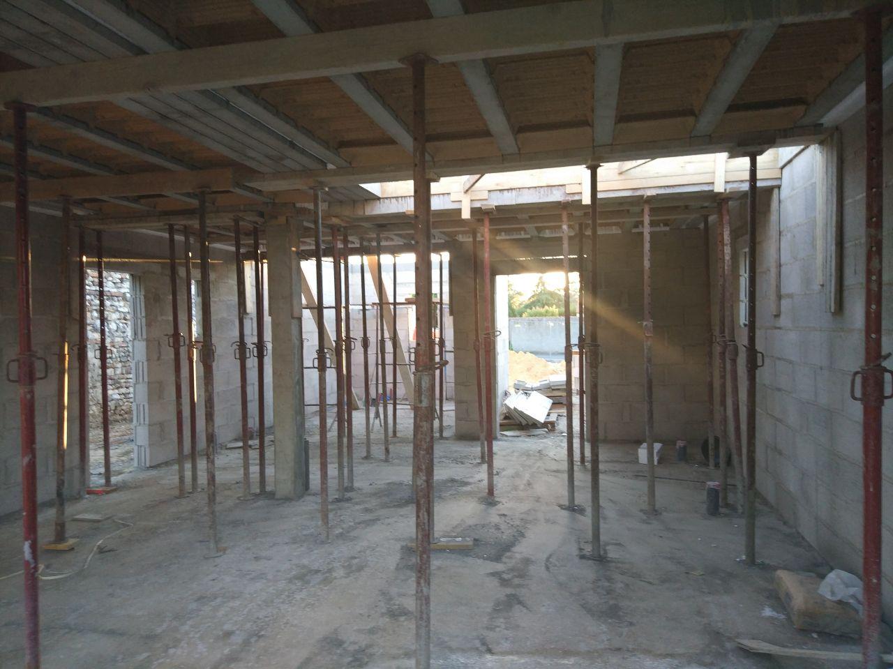 élévation des murs du RC avec poutre support dalle 1er étage