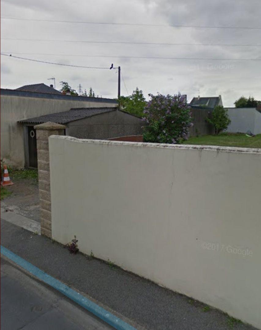 Mur et garage à démolir