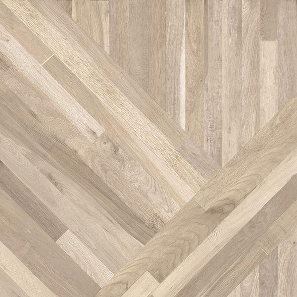 Le carrelage de tout le RDC (sauf cuisine et salle d'eau). <br /> Modèle 300° Tangram Back de la marque VIVA - carreaux de 80 x 80 cm