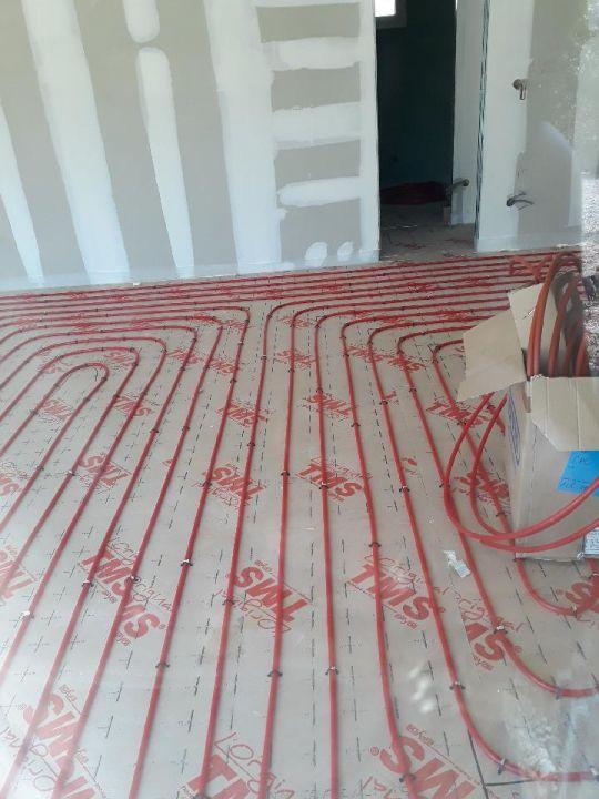 Pose du plancher chauffant/rafraichissant (salon)