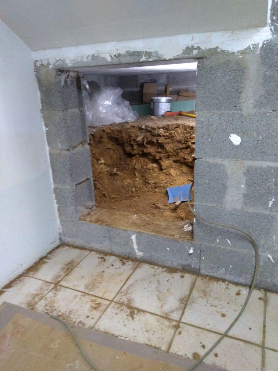 Entrée du vide sanitaire, vue cave