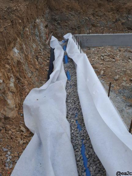 Mise en place du géotextile, gravier et drain