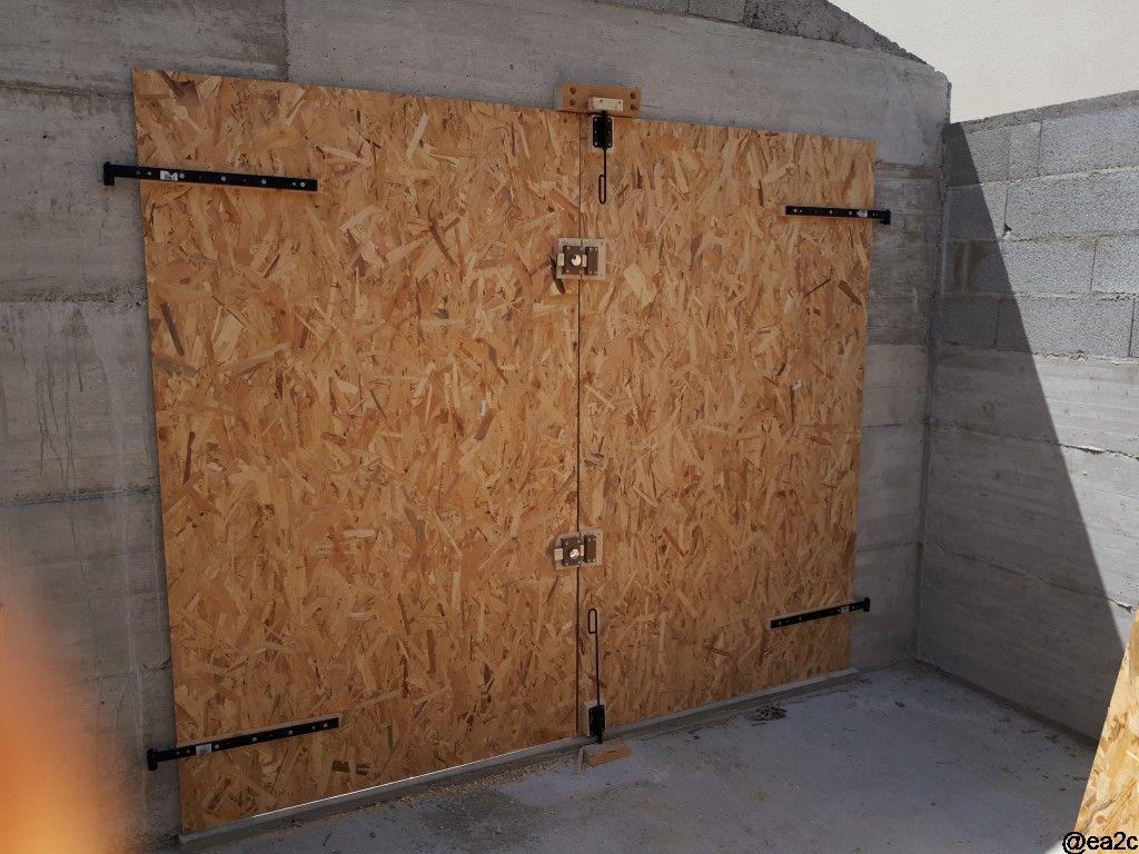 Réalisation d'une porte de garage temporaire mais bien faite