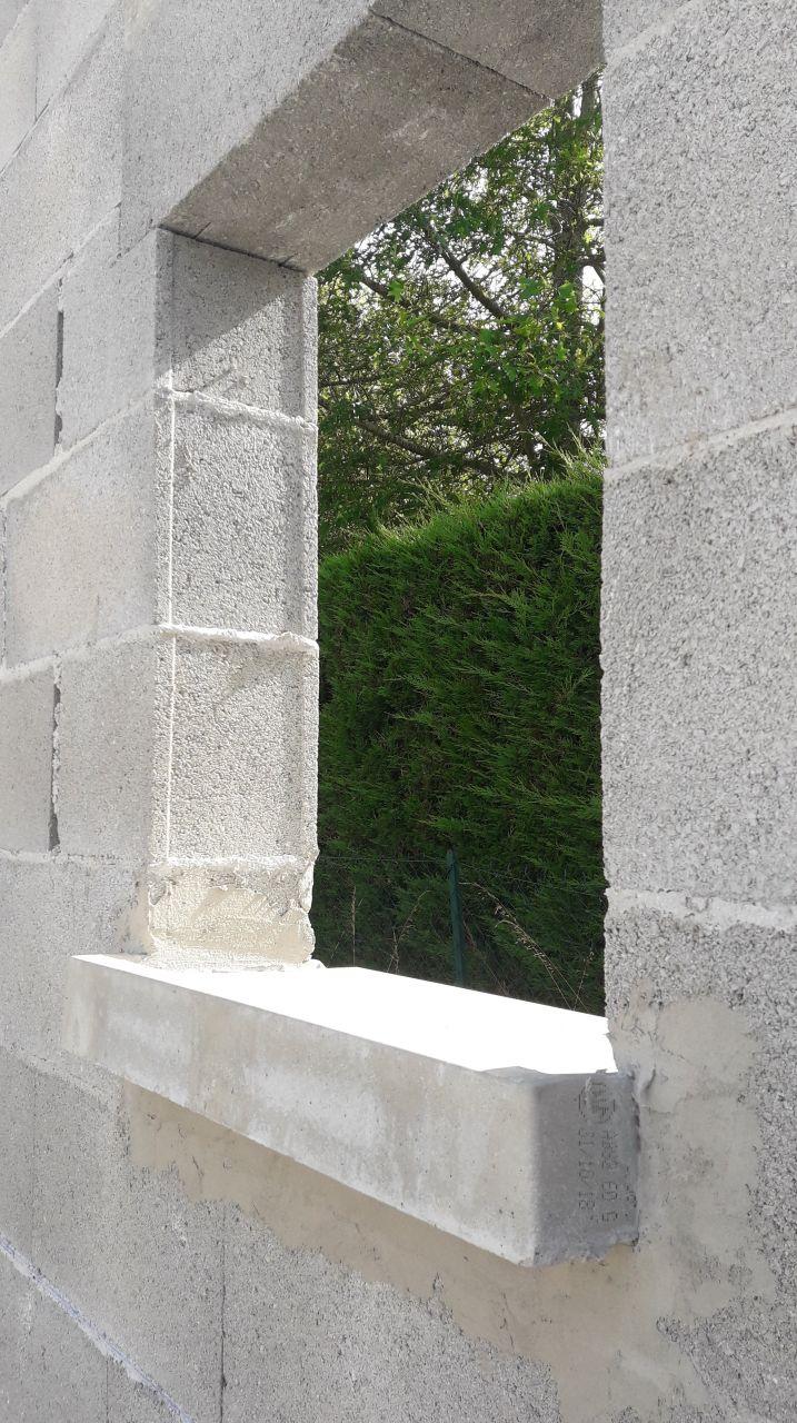 Fin de maçonnerie, vu sur fenêtre salle d'eau