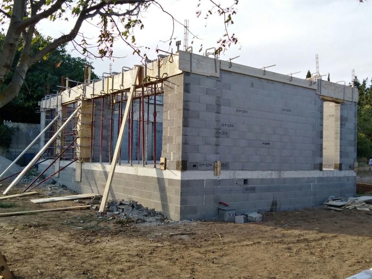 Vue façade sud coulage linteaux..