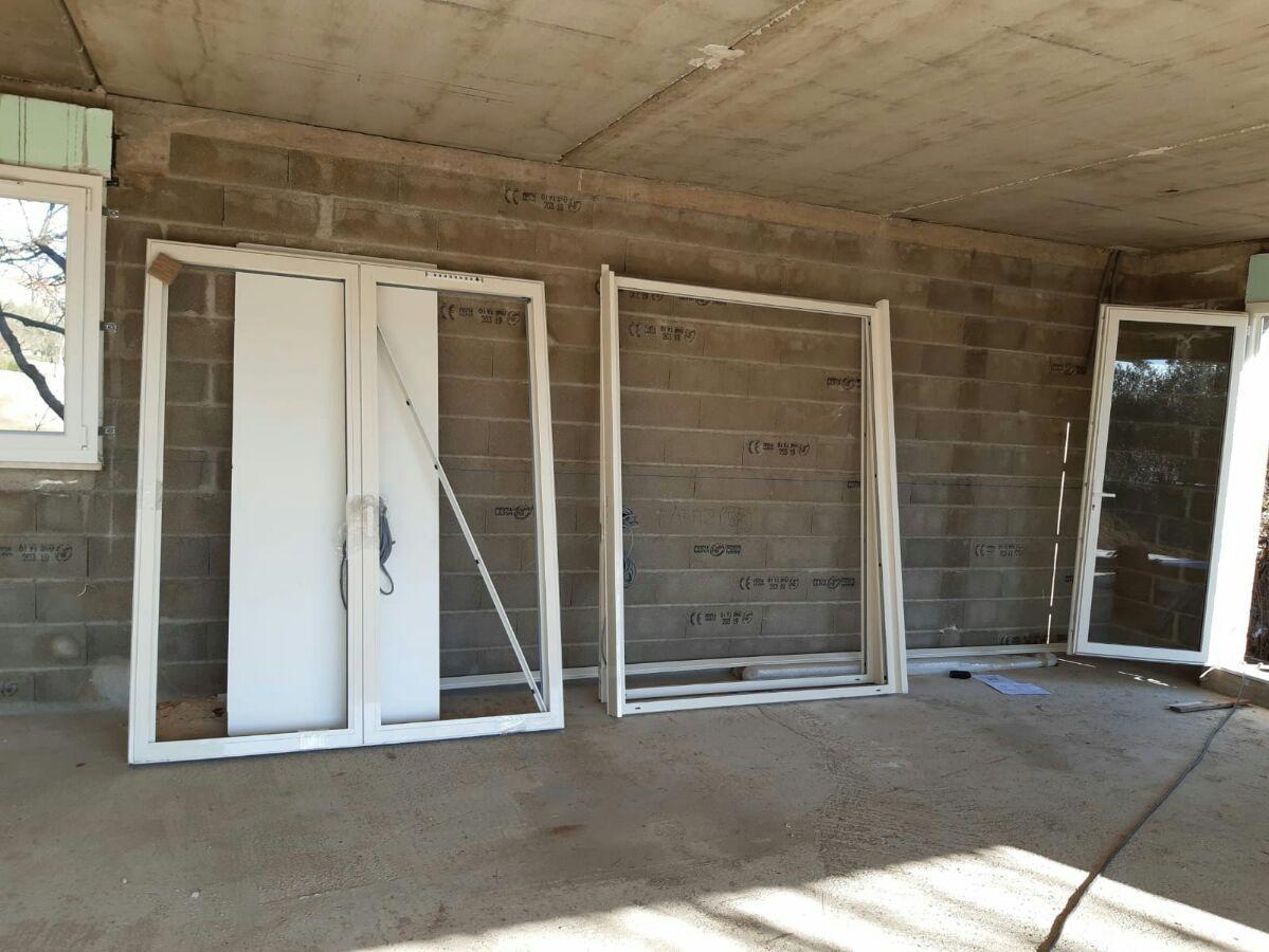 Pose des portes fenêtres alu du rdc