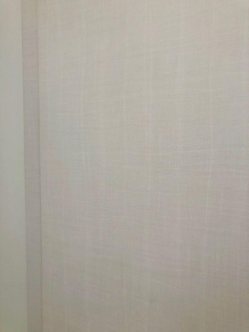 Pour nous c'est le modèle KARO blanc effet tissu chez menuiserie Della Negra à Wittelsheim (68310)