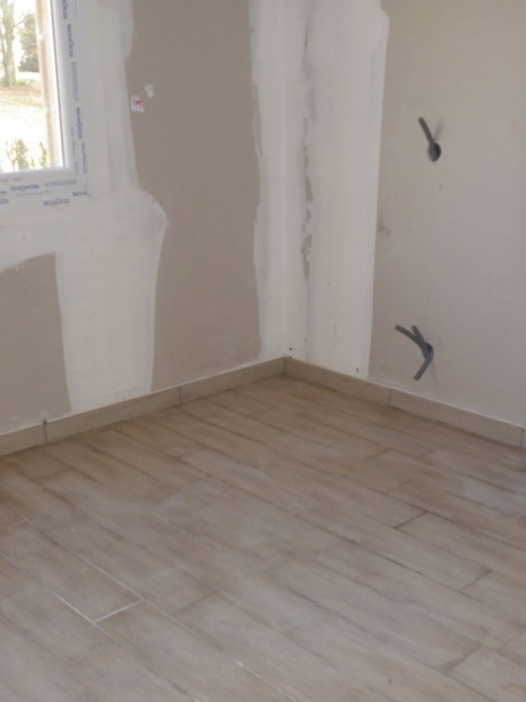 Carrelage imitation parquet retour exp rience 26 messages for Poser carrelage imitation parquet