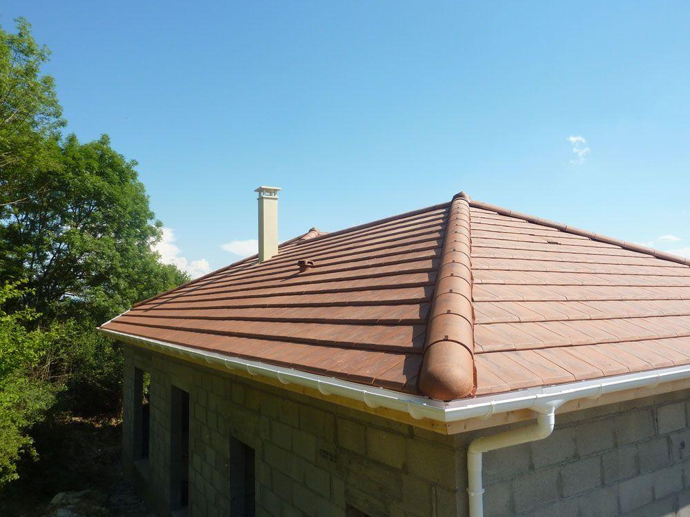 Et une belle cheminée sur un beau toit