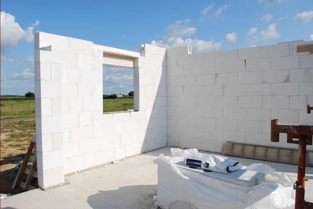 élévation des murs et poses des linteaux