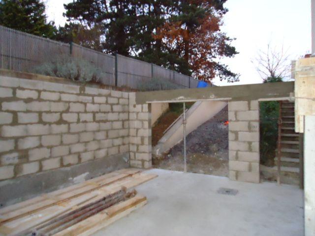 fin de l'élévation des murs de sous sol   linteau