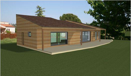Photo de la maison intégré dans une photo du terrain. Vue Sud Ouest.