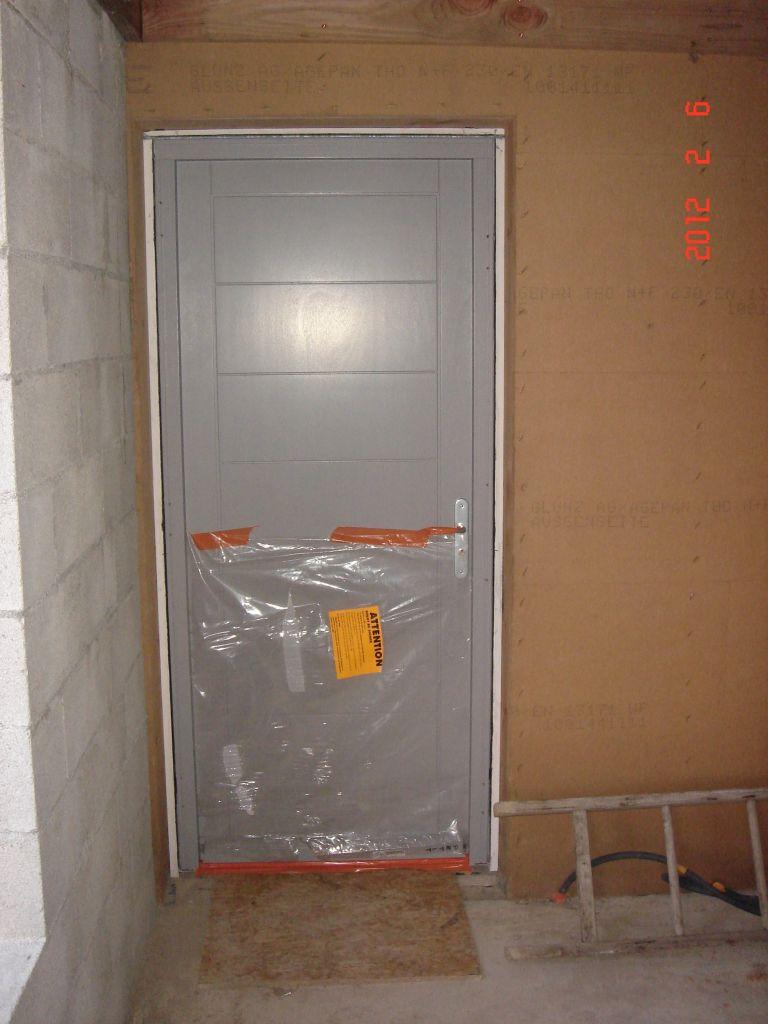 Porte d'entrée de la partie ossature bois