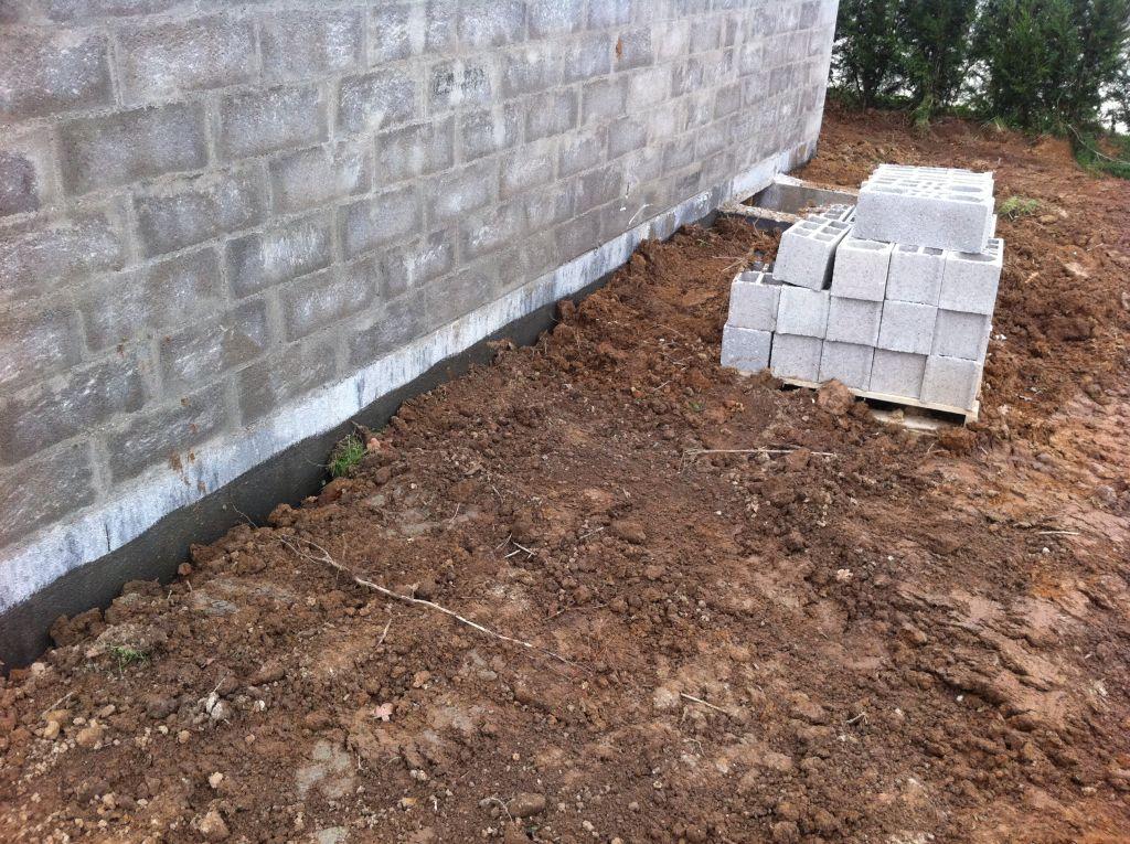 remise en état du terrain et remblais des fondations