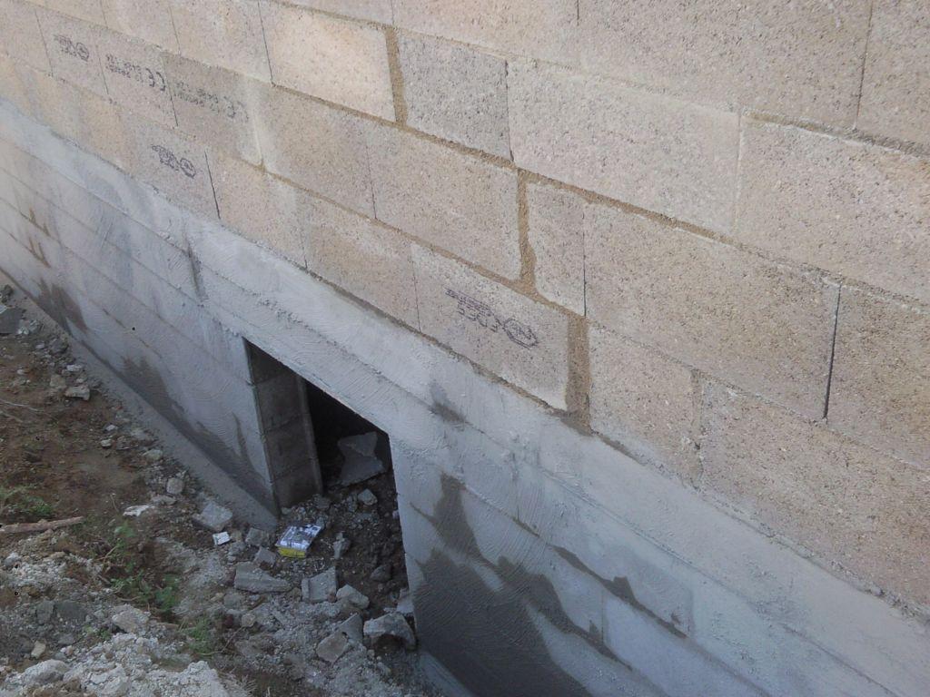 Réparations des imperfections des parpaings du mur et du vide sanitaire