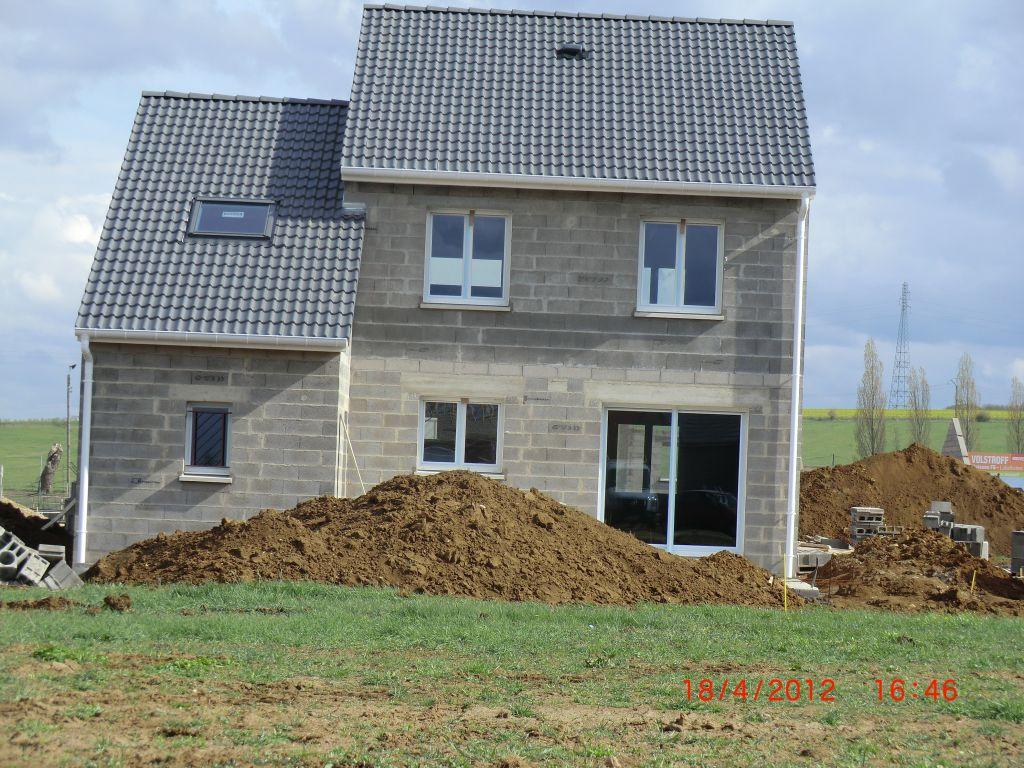 Charpente et toiture fenetre et porte volstroff for La finition d une maison