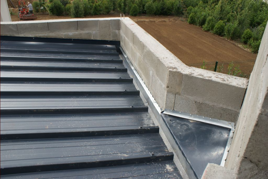 Charpente toit plat finie reprise travaux toiture for Charpente pour tole bac acier