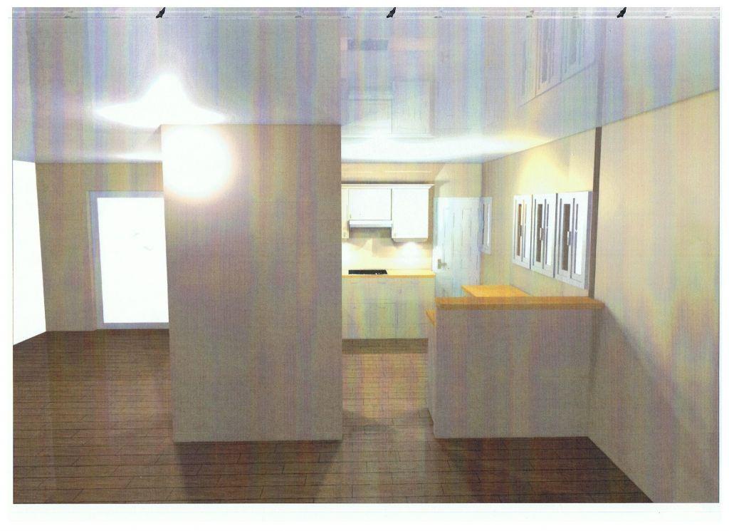 la cuisine vue de l'entrée et de la salle à manger