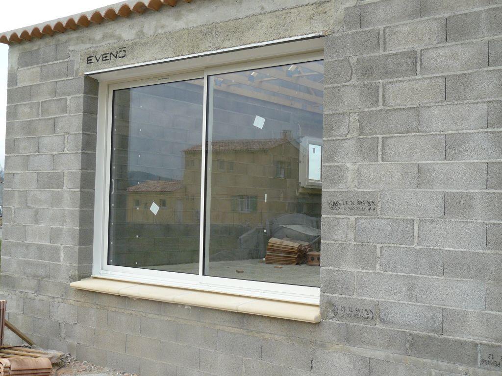 Pose de la baie vitr e pose baie vitr e pose de la for Pose baie vitree