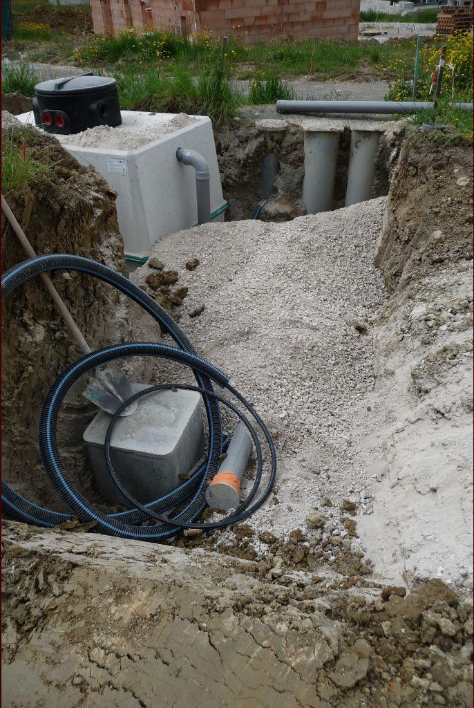 Installation de la cuve et branchements pour les eaux