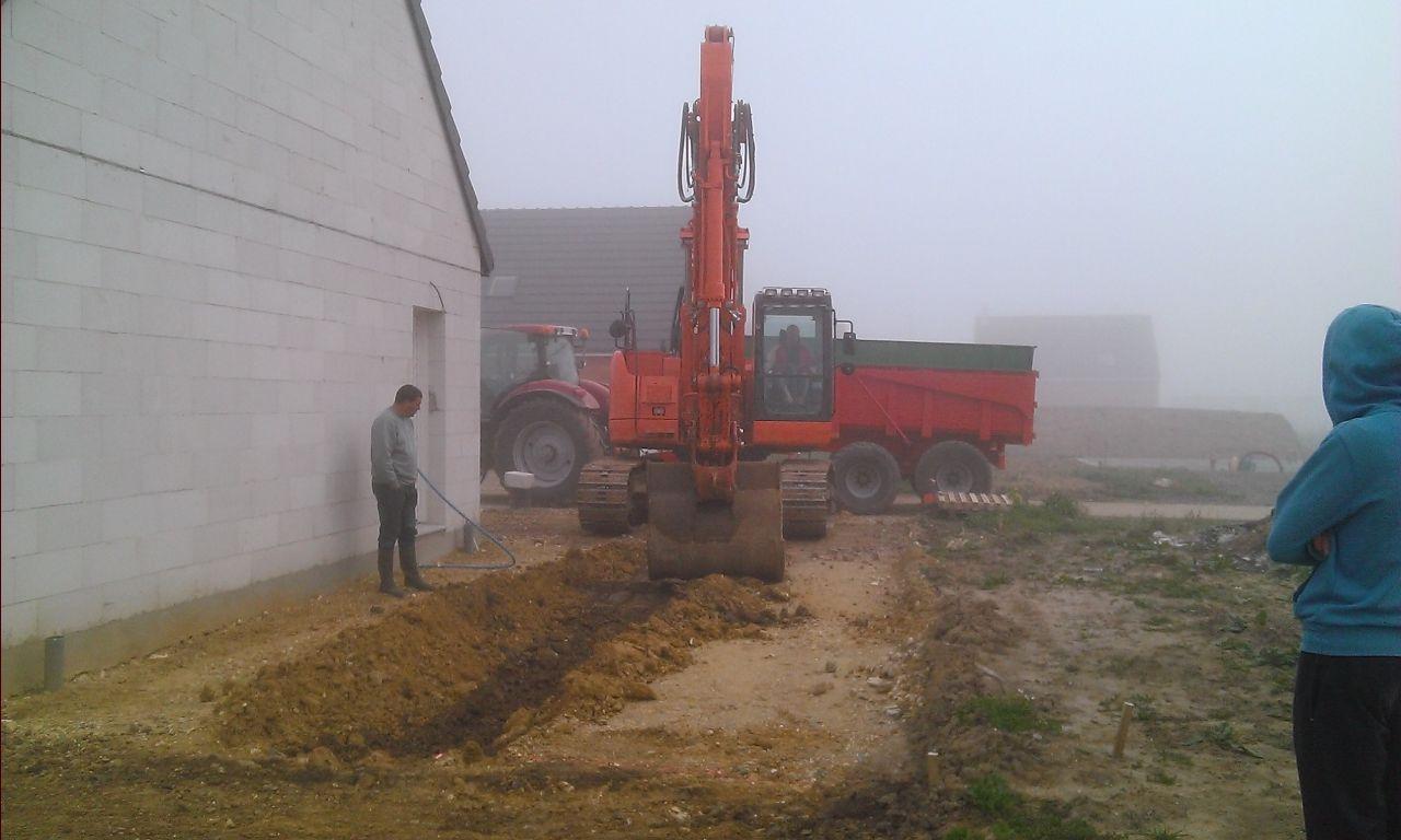 Puit eaux pluviales terrassement construction du for Terrassement garage
