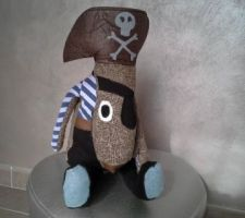 Le doudou de notre fils assorti au tons de sa chambre (turquoise et gris)