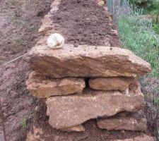 mur en pierre de retention de la terre