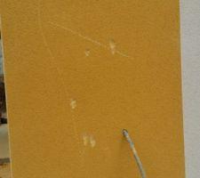piquage de la facade pour la reprise des defauts apparents apres le sechage