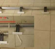 detail de l axe du volet de garage avec fixations du vr