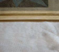 Le molleton posé sans aller près du bord ( tissu sera replié )