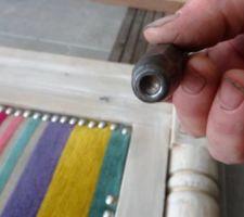 l outil qui sert a enfoncer gerard l a forme pour le mettre a la dimension du clou tapissier