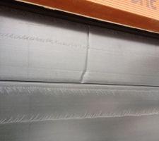 une photo de la degradation d un panneau de la porte de garage qui va etre remplace par pasquet