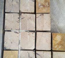 dallage en cube de chene pose bois debout sur lit de sable fin geotextile