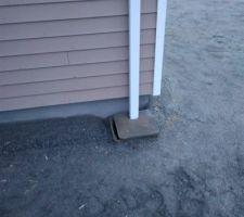 Gouttière mal axée à gauche du garage