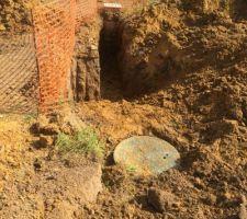 Raccordement cuve récupération d'eau / puisard