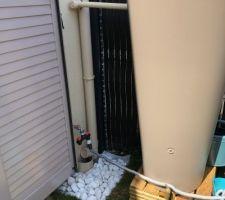 Petit aménagement sous le robinet extérieur