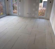 Plaque de plâtre qui se trouve entre le chauffage au sol et le carrelage